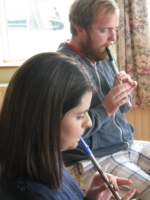 Playing the tin whistle.