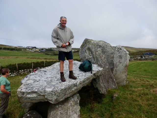 Tony Birtill, one of our experienced guides, standing on a dolmen.